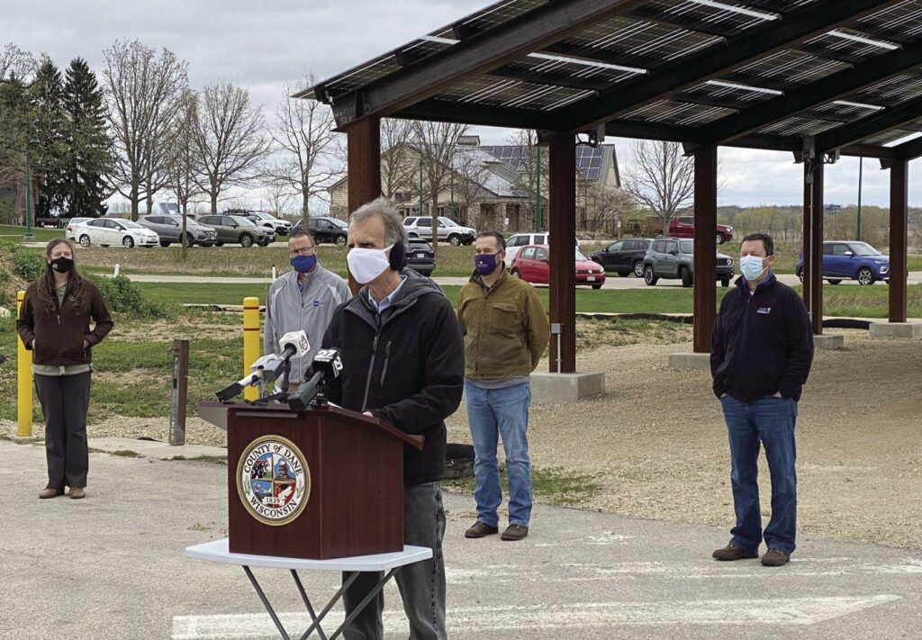 Jim Hynes and Dennis Dickman with Joe Parisi at the Dane County solar park press conference.